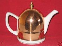 white-ceramic-old-dutch-style-tea-pot-with-copper_1_d39c36343647cc71905c08f2a8c787ce.jpg