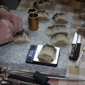 2. weighing the exact amount of hair needed to make a knot 1