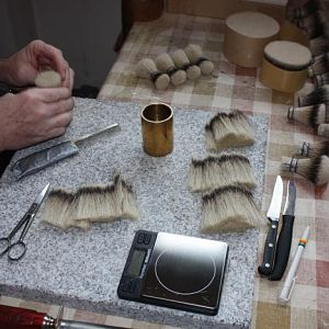 4. the forming box is tapped on the granite plate to get all the hairs aligned